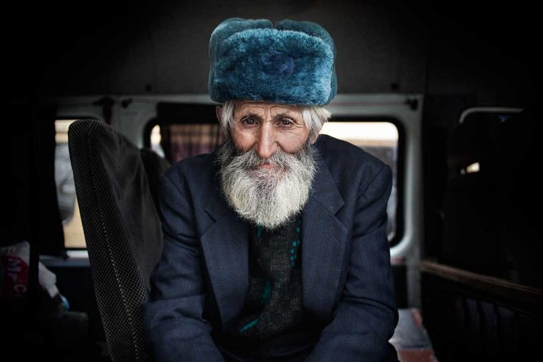 Bus station in Stepanakert. An old man waiting for the bus to leave.