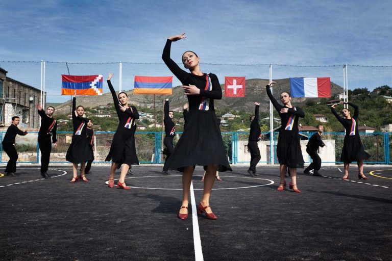 Khnabad. Dancers from the National Dance School performing during the inauguration of the sports' court, financed by Armenians living in France and Switzerland. Nagorno-Karabakh relies assistance from abroad, Armenian Diaspora in Russia, US and France are building basic infrastructures such as schools, roads and hospitals.