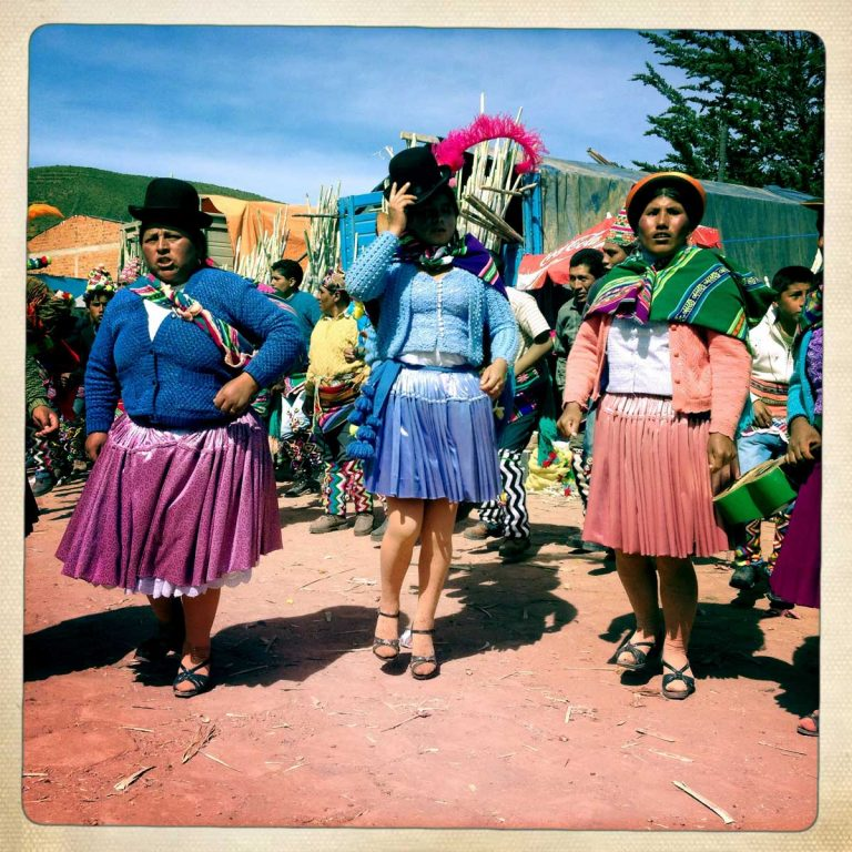 Macha, Potosì department, Bolivia. May 2014. Women dancing in traditional campesino clothes. Farmers from surrounding villages gather in Macha to celebrate Tinku, the traditional festival of Pachamama (Mother Earth). Acording to the people of the Andes, Mother Earth demands human blood to be fertilized.