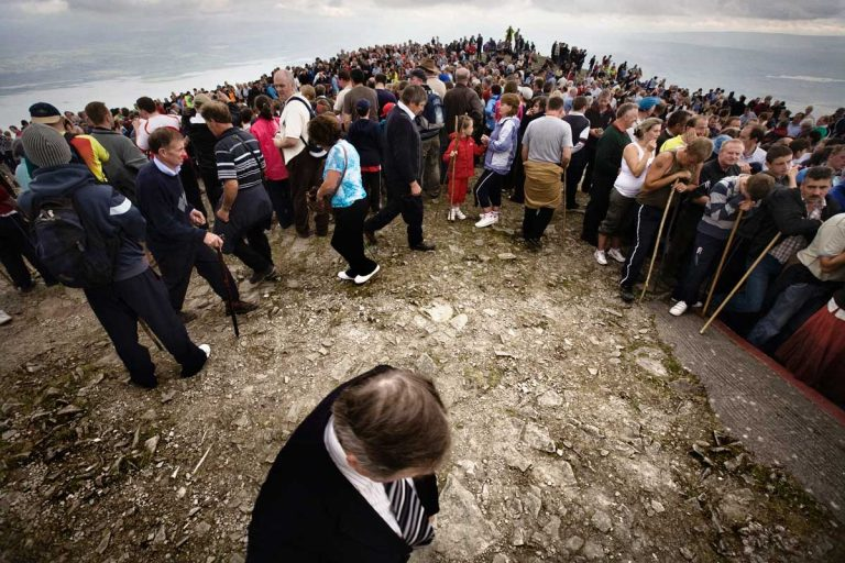 The summit of Croagh Patrick. On 'Reek Sunday', the last Sunday in July, over 25,000 pilgrims visit the Reek. Many Travellers arrive on Saturday in order to spend time with relatives or friends living far away and that can be met primarily during religious events.
