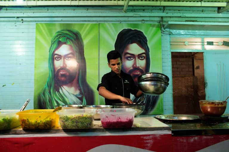 Street food stand with the images of Hussein and his brother Abbas. Iran, Ahvaz, November 2014.