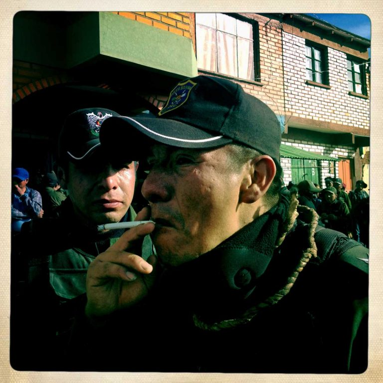 Macha, Potosì department, Bolivia. May 2014. A mix of alcohol, vanity and eagerness to fight often turn single fight into huge riots between different communities. Sometimes these events end with stone throwing and people often get badly injured. Local authorities send dozens of Policemen to watch over the fighting. When the situation gets out of control, the police use tear gas and spice gas to clear the mess. Farmers from surrounding villages gather in Macha to celebrate Tinku, the traditional festival of Pachamama (Mother Earth). According to the people of the Andes, Mother Earth demands human blood to be fertilized.