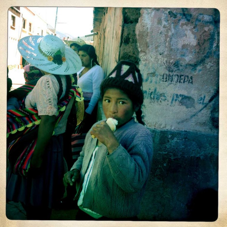Pocoata, Potosì department, Bolivia. May 2014. Kids and women also celebrate Tinku. They dance, sing and eat, always ready to support men whenever needed. Farmers from surrounding villages gather in Pocoata to celebrate Tinku, the traditional festival of Pachamama (Mother Earth). According to the people of the Andes, Mother Earth demands human blood to be fertilized.