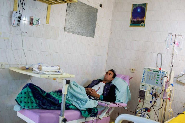 Ghaffar undergoes dialysis three times per week. Each session lasts three hours, during which his blood is purified by an artificial kidney machine. Iran, November 2014.
