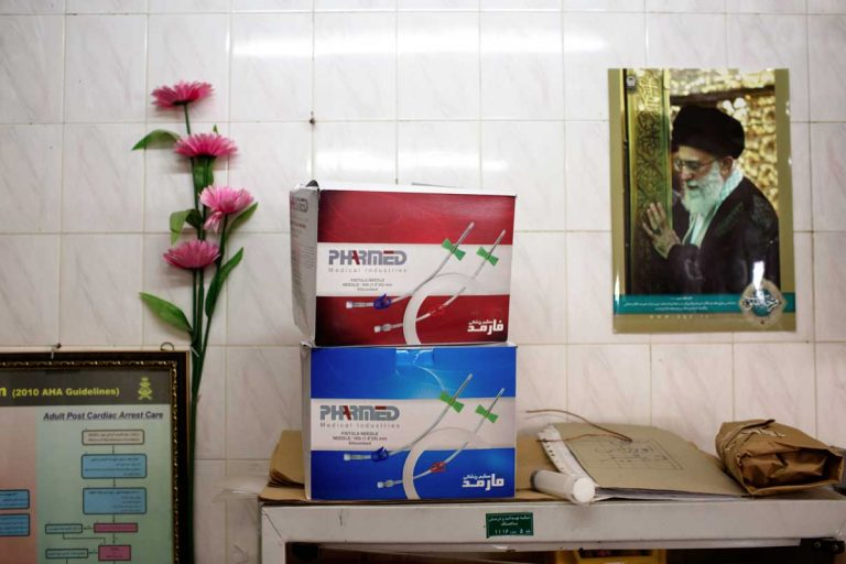 The image of the current Supreme Leader of Iran, Ayatollah Ali Khamenei, on the wall of the dialysis centre where Ghaffar has been treated for the past six years. Iran, November 2014.