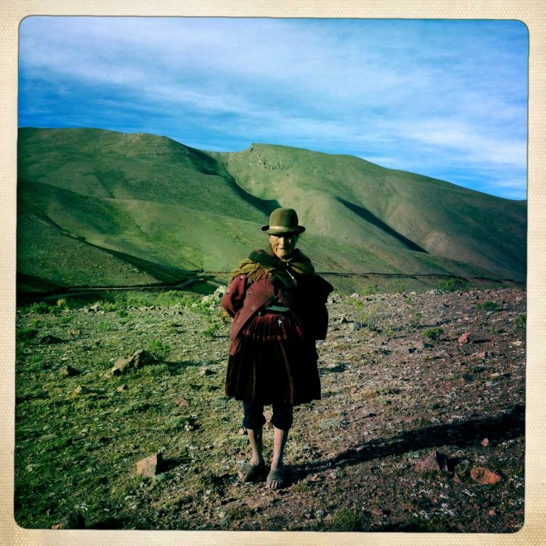 Potosì department, Bolivia. May 2014. A woman stands at over 4000 metres in the Bolivian Andes. During Tinku most of the elderly people remain at home looking after their cattle. Tinku is a traditional festival of Pachamama (Mother Earth) where farmers ask for a good coming harvest through blood sacrifice.