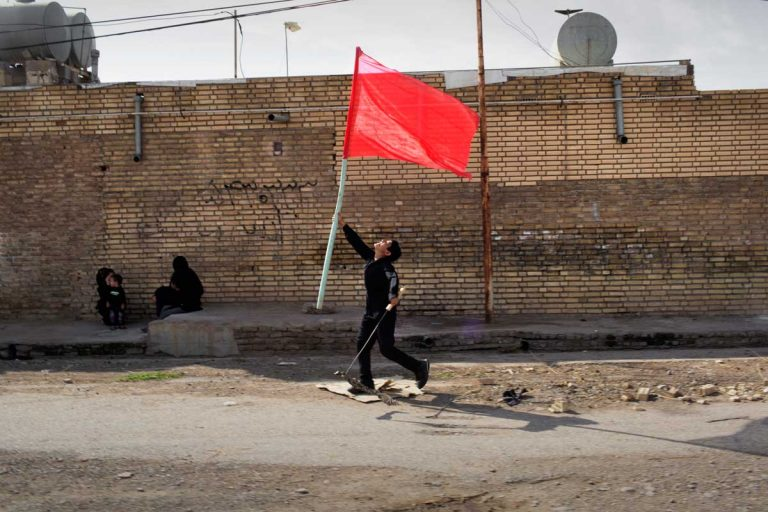 During the Ashura, the red color depicts the enemy and killer of Hussain. Some Iranian shiite link the red color of the enemy with US and Israel. For other Iranians, mainly the young generation, the enemy wearing red is the Iranian regime. Iran, Shush, November 2014.