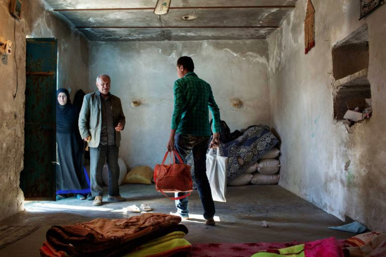 Ghaffar is about to leave his home for the hospital where he will be transplanted the kidney. Iran, November 2014.