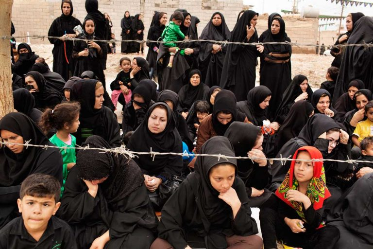 Women attending the play of the martyrdom of Hussein. Iran, Shush, November 2014.
