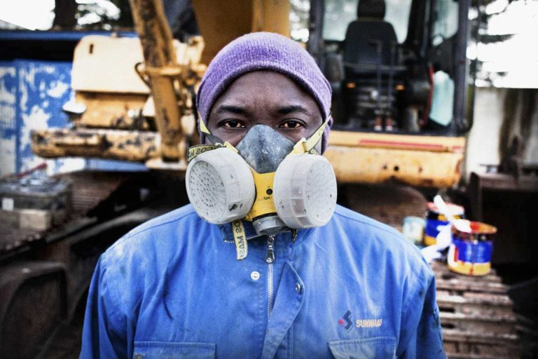 """Ansu David from Cote D'Ivoire who works as a sprayer in Marcianise, Caserta. """"The best day since I have come to Italy was when my boss tested me as a sprayer and he told me I am very good and qualified, he gave me the job."""""""