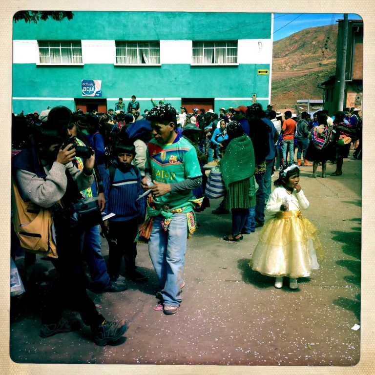 Pocoata, Potosì department, Bolivia. May 2014. Kids and women also go to celebrate Tinku through dancing, singing and eating, ready to support the men. Farmers from surrounding villages gather in Pocoata to celebrate Tinku, the traditional festival of Pachamama (Mother Earth). Acording to the people of the Andes, once a year Mother Earth demands human blood to be fertilized.