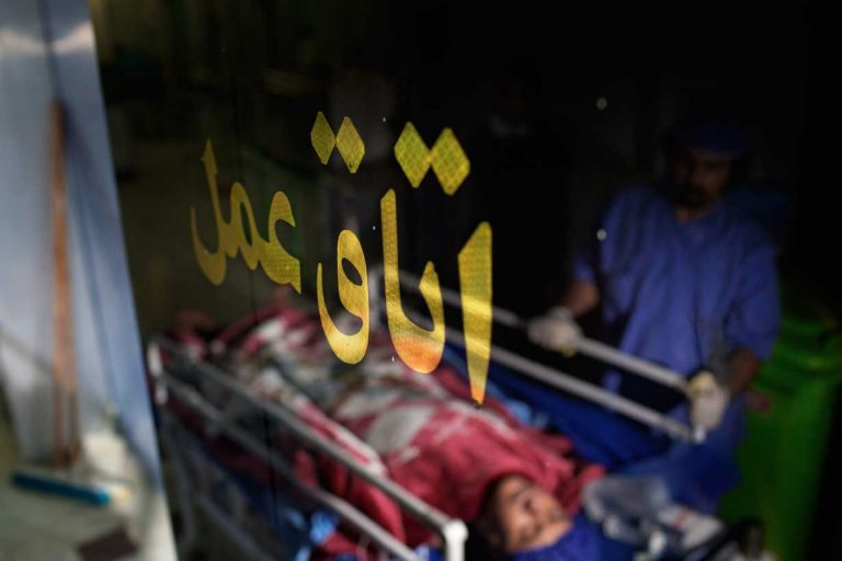 Ghaffar leaves the operating room on a stretcher after being implanted Narinâ??s kidney, which he has bought for â?¬ 4,600. Iran, November 2014.