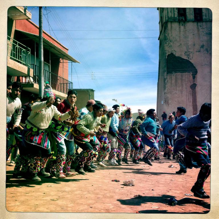 Macha, Potosì department, Bolivia. May 2014. A community is dancing during Tinku. Farmers from surrounding villages gather in Macha to celebrate Tinku, the traditional festival of Pachamama (Mother Earth). Acording to the people of the Andes, Mother Earth demands human blood to be fertilized.