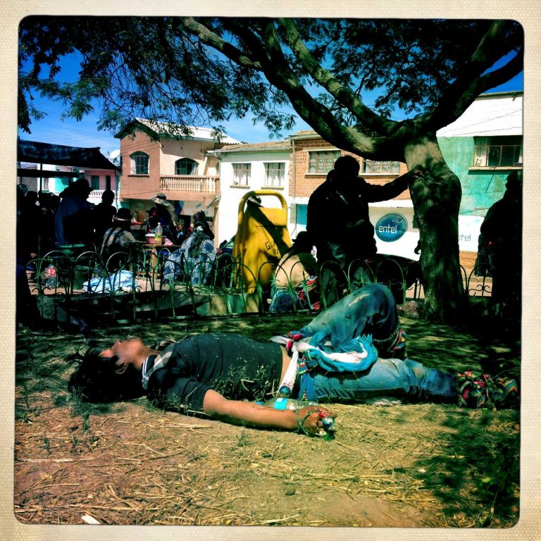 Pocoata, Potosì department, Bolivia. May 2014. A young man lying on the ground after a fight. His hands are wrapped in cloth that is the most traditional way of fighting. Years ago fighters used to fight with stones to ensure the bloodshed. Farmers from surrounding villages gather in Pocoata to celebrate Tinku, the traditional festival of Pachamama (Mother Earth). According to the people of the Andes, once a year Mother Earth demands human blood to be fertilized.