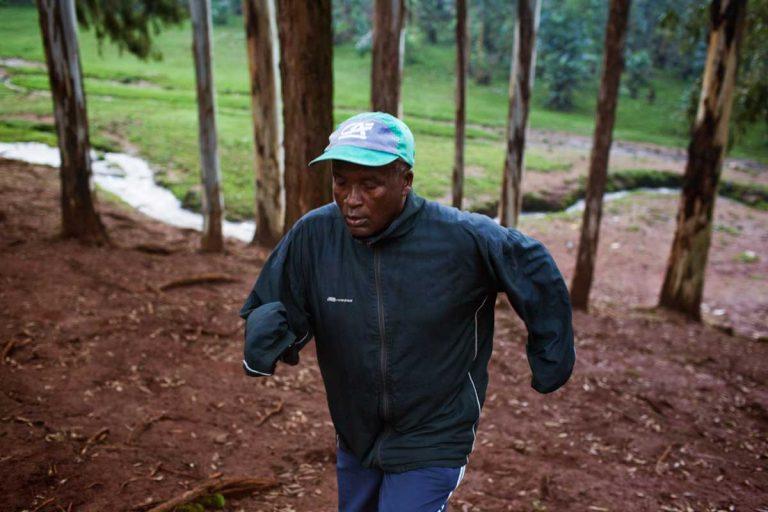 "Bekoji, Ethiopia. August 2013. Sentayehu Eshetu, who everybody in Bekoji calls ""the coach."" He trains every morning in the forest before going to work."